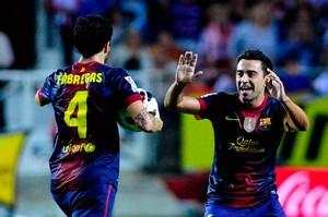 Cesc i Xavi w meczu z Sevillą.